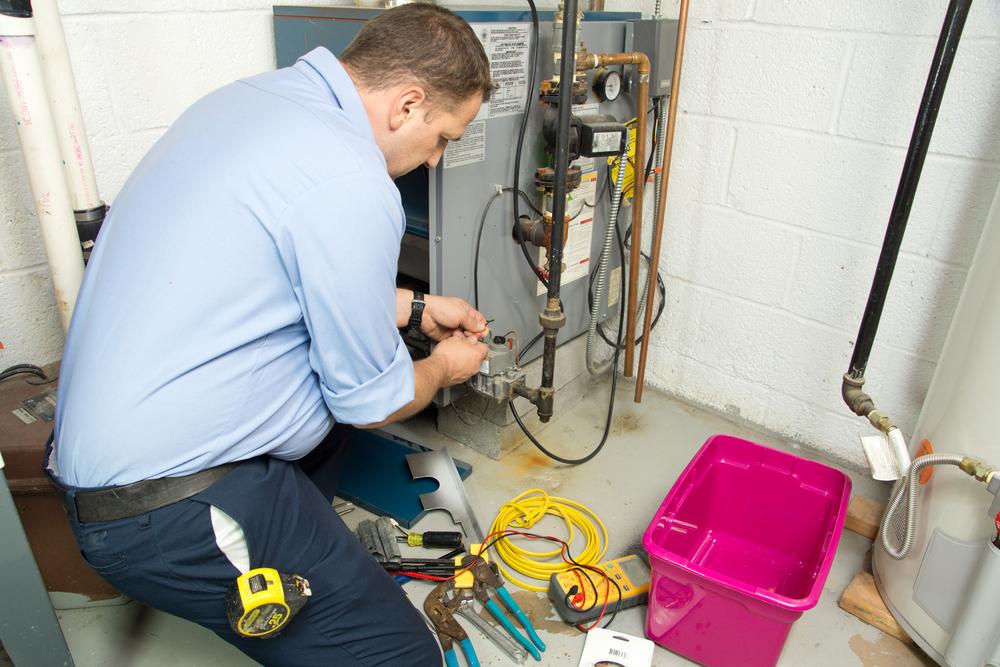 Technician Repairing Furnace