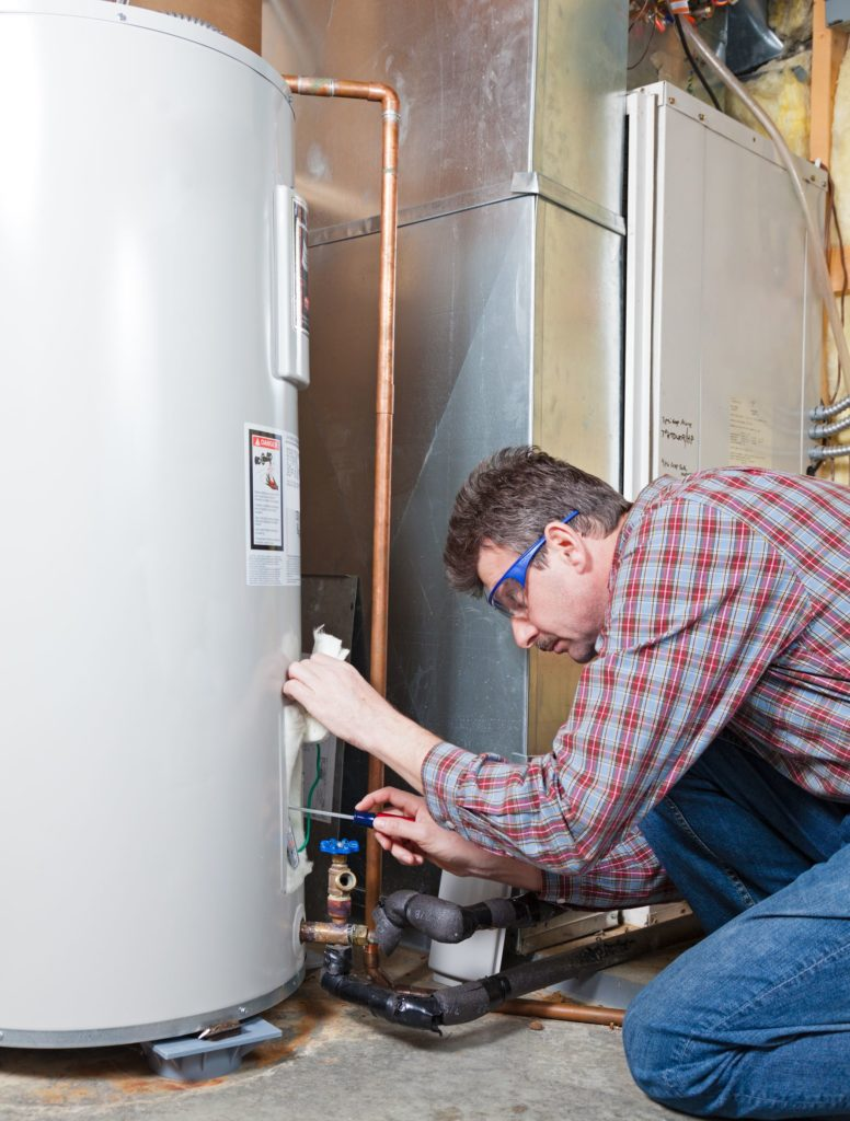 a technician working on boiler repair in auburn